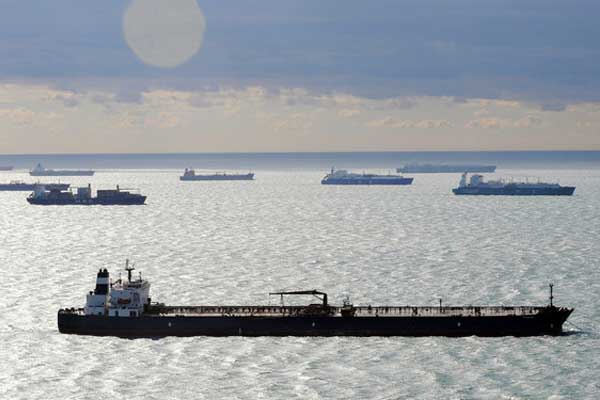 Oil tankers anchored offshore (Image: EV World)