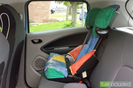 A large child's car seat fitted in the rear of our Renault ZOE (Image: T. Larkum)
