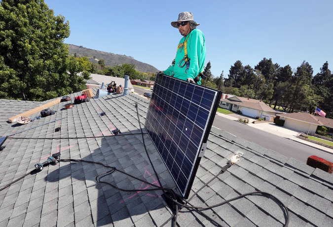 A solar panel being installed at a home in Camarillo, Calif. The state aims to get 50 percent of its energy from renewable sources by 2030. (Image: J.E. Flores/NYT)