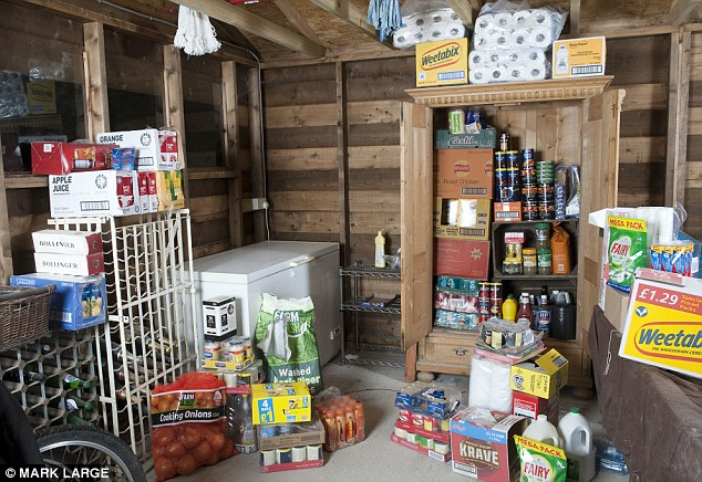 Reserves: The Shaws have enough food and water to last them a year, stored in their garage (Image: M. Large/Daily Mail)