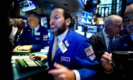 Traders on Wall Street during a summer of market turmoil triggered by China's attempt to increase its flagging exports with a devaluation of its currency (Image: J. Lane/EPA)