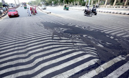 In India last May, temperatures rose to 120°F (50°C), killing more than 2,300 people—and melting this street in New Delhi (Image: H. Tyagi/EPA)