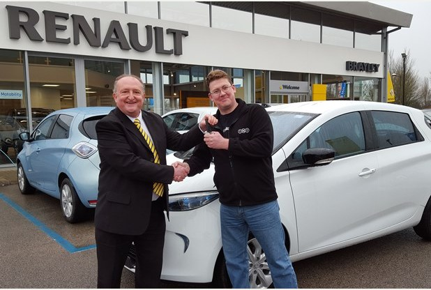 David Wallace from Oxley Park, Milton Keynes, receives the keys to his new Renault ZOE from Brayleys' sales executive, Graham Glover