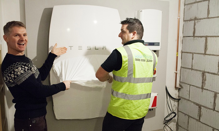A SolarPlant engineer installs the UK's first Powerwall home battery in Cardiff at Mark Keer and Lyndsey Bennett's home (Image: G. Phillips/Guardian)