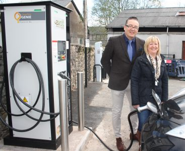 John Osorio of Evolt and Cllr Janet Willis, Cumbria County Council Cabinet member for Environment, at the charging site in Kendal (Image: Evolt)