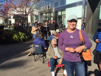 Photo Credit:Leslie R in San Diego waits in hours-long line to pre-order the Tesla Model 3. Tesla Motors received more than 250,000 pre-orders within 72 hours of the vehicle's unveiling
