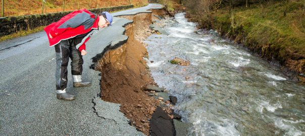 A Cumbria road destroyed in floods during storm Desmond, which scientists found had been made more likely by climate change (Image: A. Cooper/Barcroft Media)