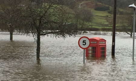 Flooding in the village of Aberfeldy, Perthshire, Scotland, 2015. Critical infrastructure, such as water and telecoms, are at serious risk from floods (Image: C. Webster/PA)