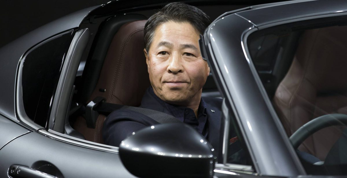 Masamichi Kogai, president and chief executive officer of Mazda Motor Corp., at the wheel of the company's Roadster RF in Tokyo last week. Mazda said it would introduce an electric car by 2019. (Image: Bloomberg)
