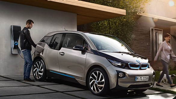 Charging a BMW i3 on the drive (Image: BMW)