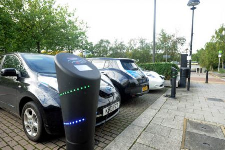 Electric cars in charge point bays - no 'RESERVED' marking so they do not need to be plugged in